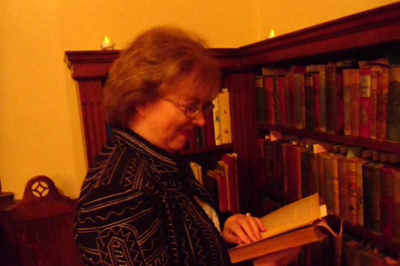 NCTE staff member, Barbara Cambridge, checking out a book in Houston Library